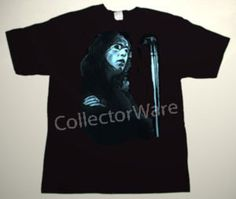 GENESIS Peter Gabriel drawing 13 CUSTOM ART UNIQUE T-SHIRT  Each T-shirt is individually hand-painted, a true and unique work of art indeed!  To order this, or design your own custom T-shirt, please contact us at info@collectorware.com, or visit  http://www.collectorware.com/tees-genesis_andrelated.htm