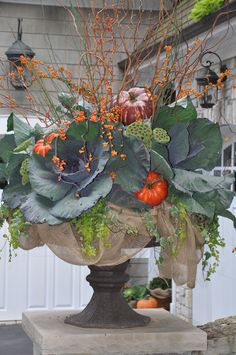 fall container. Mine would never look like this, but I love the burlap at the bottom
