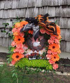 Harley Love-square wreath frame (*Harley Davidson stuff was supplied) orange gerbs, carnations, roses, kermits, fugis, black thistle & italian ruscus