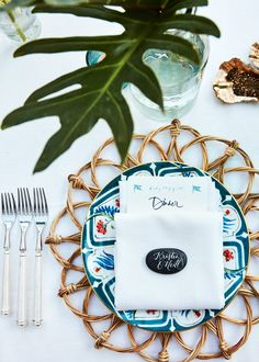 The plates are made by the same family that owns Le Sirenuse—the iconic Positano hotel. Chiara Perano of Lamplighter London did all of the calligraphy for the weekend. She handwrote guests' names on black rocks and created the most beautiful menu that was inspired by a nearly 1900s-era beach club menu that I found. Fiona Leahy also made the salt and pepper cellars out of oyster shells herself.