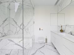 """might be a little too """"white"""" but the idea of one long sink glass shower and integrated tub...strikes me as beautiful"""