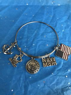 A personal favorite from my Etsy shop https://www.etsy.com/listing/268614242/handcrafted-united-states-navy-mom-charm