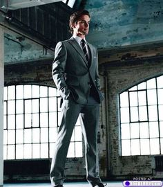 Impeccable gray suit and buckets of charisma? The one, the only, Neal Caffrey (Matt Bomer)