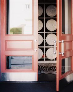 Hollywood Regency Doors: Pink front doors with Lucite handles.