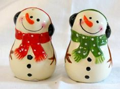"Gift Craft Red & Green Ceramic Snowman Salt & Pepper Shakers # 689855 by Gift Craft. $10.00. They match the other red and green snowman table top pieces from Gift Craft. Set of 2, one is dressed in a green scarf, and the other in a red scarf.. Really adorable ceramic snowman salt & pepper shakers.. 3"" T x 2"" Round. Ceramic salt and pepper shakers in the shape of snowmen.. Save 17% Off!"