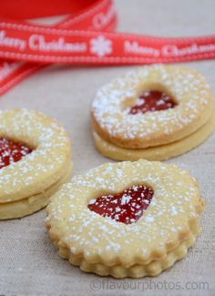These are little Swiss jam-filled shortbread cookies called Spitzbuben (roughly 'scoundrels' or 'cheeky rascals'), but the Scandinavians have adopted them and made them a holiday favorite. Recipe here. Swiss Desserts, Swiss Recipes, Cookie Desserts, Vegan Desserts, Cookie Recipes, Dessert Recipes, Czech Desserts, German Recipes, Jam Cookies