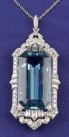 Art Deco Platinum, Aquamarine and Diamond Pendant, set with a step-cut aquamarine measuring approx. 23.20 x 16.55 x 10.10 mm, framed by eight baguette, four bullet, one triangular, fifty-eight full, and twelve single-cut diamonds, approx. total diamond wt. 2.95 cts., open gallery.