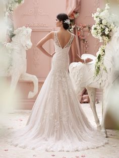 David Tutera for Mon Cheri | Style No. › 115234 | 2015 Wedding Dress Collection– Sleeveless hand-beaded corded lace appliqué, tulle and organza over satin slim A-line wedding dress features a jeweled illusion bateau neckline edged with beaded corded lace, softly curved hand-beaded corded lace appliquéd bodice with dropped waist, illusion and beaded lace plunging deep V-back bodice, softly gathered tulle and organza skirt with matching [...]