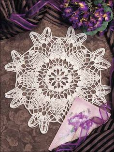 "Spinning Wheel Doily This beautiful doily can be made in less than five hours. Size: 10 1/2"" in diameter.  Skill Level: Beginner Designed by Josie Rabier"