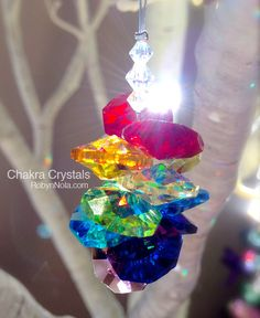 Chakra Crystal Sun Catcher - I've made similar products myself. Love all the prisms dancing about my lounge room on a sunny day :)