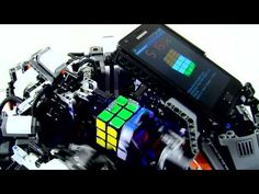 Mike Dobson and David Gilday built and programmed an ARM-powered robot out of LEGO, that can solve a Rubik's Cube puzzle faster than the. Lego Rubiks Cube, Rubik's Cube Solver, Lego Engineering, Lego Nxt, News Anime, Cube World, Lego Machines, Lego Mindstorms, Cubes