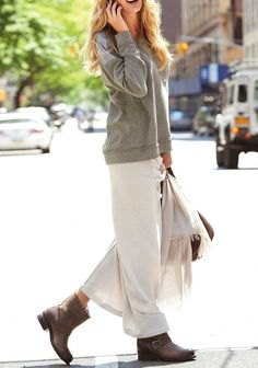 Boho casual. I'm not a fan of boots (except in winter), but I like the overall look. And it looks comfy!