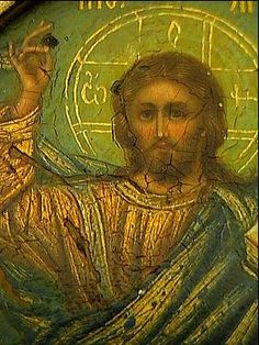 An antique Russian Icon of Christ Pantocrator by Faberge, made in Moscow between 1908 and 1917.  Silver-gilt oklad (riza) is shaped as a panagia, decorated in the Russian Moderne style of the 1910s with stylized berries and branches on green matte enamel ground.