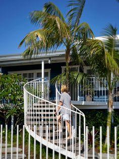 Beach House On Stilts by Luigi Rosselli Architects | elliptical external steel staircase | © Justin Alexander #LuigiRosselliArchitects #LuigiRosselli #Architecture