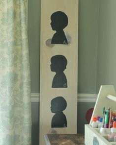 Paint silhouettes of multiple children and create a Silhouette Memory Board- OneKriegerChick.com