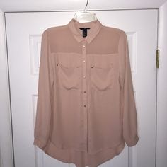 H&M Sheer Nude Color Button Down Blouse This blouse is in PERFECT condition. NWOT. Never wore this top. The color is a sheer nude. Size is US 6. Can work with cami underneath. Perfect by itself, under a sweater, or paired with black pants! H&M Tops Button Down Shirts