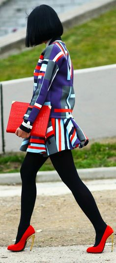 bold. color blocking. black tights with red heels!