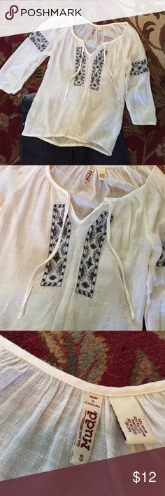 Top Cute white top with pretty blue design on front and arms. Elastic waist. Super cute with blue jeans. Mudd Tops Blouses