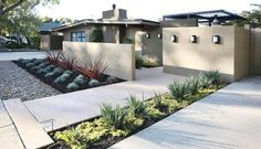 There's more than one way to make a good first impression. Multiple approaches redefine what curb appeal means, especially in front of a contemporary home.