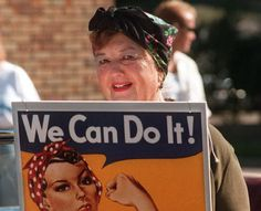 """Geraldine Hoff Doyle smiles and poses for a photo with the WWII Rosie the Riveter poster that was made with her likeness."" ""Geraldine Doyle, who as a 17-year-old factory worker became the inspiration for a popular World War II recruitment poster that evoked female power and independence under the slogan ""We Can Do It!,"" died Dec. 26 2010 in Michigan. She was 86."""