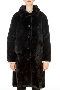 This is the 'Zonna' Black Long Faux Fur Coat by our friends at Rino & Pelle! The Rino and Pelle Zonna coat is a statement piece of outerwear for the winter season, offering a glamorous look with its beautifully crafted faux fur outer and elegant longer length. This all-occasions coat features stylish horn buttons to the front, a notched lapel and two inseam pockets to the front with a soft fleece lining, while a leopard print satin lining to the inside lends a chic finishing touch. Long Faux Fur Coat, Winter Coats Women, Shop Now, Glamour, Winter Season, Stylish, Horn, Jackets, Satin