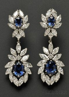 Platinum, Sapphire, and Diamond Day/Night Earpendants, set with cushion-shape sapphires framed by marquise and full-cut diamonds, purchased in the 1970s from Cartier. Description from pinterest.com. I searched for this on bing.com/images