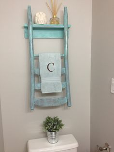 Repurposed chair back towel rack/shelf