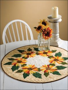 Spinning Sunflowers Topper Quilt Pattern Download from e-PatternsCentral.com -- Prolong the last blossoms of the growing season with an elegant table topper.