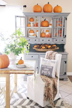 Show off your love of fall by designating a spot in your home that can be easily switched up seasonally. This hutch is quite the statement piece, bringing all eyes to your pumpkins.  See more at Paint Me Pink.