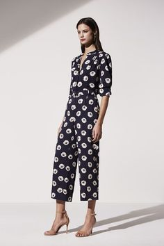 Work Outfit Idea from Ann Taylor: A Black Jumpsuit in a Modern Pattern // Explore More Work Style Ideas from Ann Taylor: (http://www.racked.com/2015/10/30/9642804/ann-taylor-spring-2016-collection#4867343)