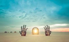 He rises from the desert. This is a great sculpture about becoming conscious and being the awareness inside your mind. You can even crawl in through the ear. - Burning Man, Nevada - Photo from #treyratcliff Trey Ratcliff at http://www.StuckInCustoms.com