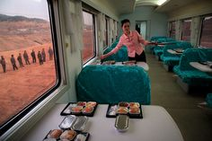 A waitress serves lunch on a train heading to North Phyongan province.