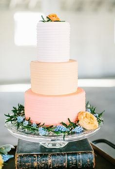 Peaches and cream is such a sweet yet sophisticated wedding palette, and this cake by Baked Custom Cakes completely proves our point. Thin strips of fondant, in... #weddings #weddingcakes #cakes.