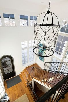 High ceilings? We love this option! @blackdoghomes #moderndesign #decor #interior #remodeling #daytime #architecture #building #interiordesign #wood #line #wall #windows #architecturelovers #archilovers #realestate #curbappeal #interiordecor #chic #interiordesigns #decordesign #interiors #fixture #materialproperty #architecture_hunter #architecturaldesign #architecturephotography #lovedecor #roomdecor #interior4inspo #interior4all #dreamhome #housegoals #homedesign Two Story Foyer, Properties Of Materials, Interior Decorating, Interior Design, Transitional Decor, Custom Lighting, House Goals, Cage, Architecture Design