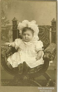 #Photograph of a #Victorian baby, wearing a frilly bonnet.