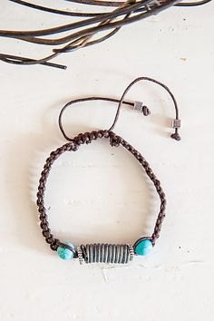 adjustable snare wire cord bracelet with torquoise stone