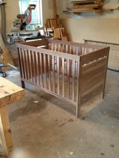 My wife and I are expecting our first (boy) in the next couple weeks so it was probably time I got this project finished up! I adapted the design from a crib we saw online with a few small modifications. It is made of solid walnut and finished wit. Wooden Baby Crib, Baby Crib Diy, Baby Cribs, Woodworking Projects Diy, Woodworking Plans, Wood Projects, Baby Crib Designs, Baby Furniture, Baby Room Decor