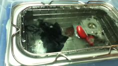 Ultrasonic Cleaner by Vibrato, LLC. in the process of cleaning gas-powered weed-eater engine parts. Vibrato Ultrasonic Cleaners available on tindie.com