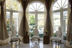 Beautiful flowing drapes add interest to these fabulous bright windows.     - Katy Custom Decor and More