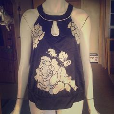 Hot black & white floral halter top This silky halter top has a large black & white floral print & white piping detail. Beautiful lightweight top for a date, work or fun summer day! The Limited Tops