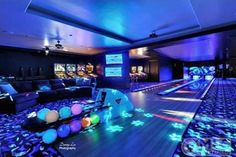 Home game room with bowling alley. Omg I need to make lots of money because I want this! This is too cool!