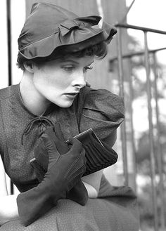 Katharine Hepburn looking like she's deep in thought while sporting a lovely puff-sleeved dress. #vintage #1940s #actresses #fashion #hats