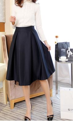 Box pleated mid length office skirt with hidden back zipper available in M-XL in navy, red, black and green