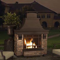 """The perfect solution to make your outdoor living area a new favorite """"hot spot"""", the Sunjoy Steel Outdoor Fireplace is sure to be a welcome addition to any home. The appealing design resembles that of an indoor fireplace; complete with a mantle and chimney - except this fireplace is built to withstand the elements. The fully functional chimney will help to funnel smoke up and away from those gathered around the fire. Two large screen doors keep embers from popping out of a crackling fire…"""