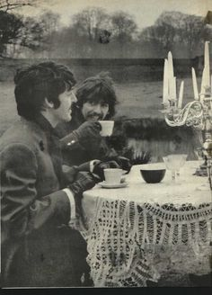 """Paul McCartney and George Harrison during the filming for the song """"Strawberry Fields"""""""