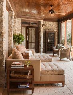I want to curl up on these loungers in this screened patio...