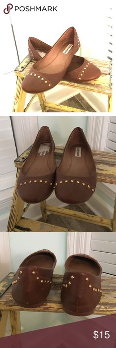 Brown Studded Flats Beautiful, like new condition slip on flats by Steve Madden.  Recently purchased by a fellow posher that only wore them once.  Sold to me as a 9, and the size in the shoe faintly resembles a 9(so lightly printed it's almost illegible).  Long story short my feet are too wide for these beauties and they are a smidge too snug!!!  Best suited for a 8.5 small 9 narrow.  Studs are gold.  Sticker remnants on inside of R shoe.  free home that has a Yorkie!!! Steve Madden Shoes…