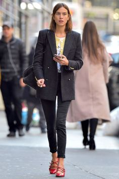 Alexa Chung was spotted in NYC looking her usual stylish self in a pair of skinny jeans, red Mary-Janes and a long blazer.