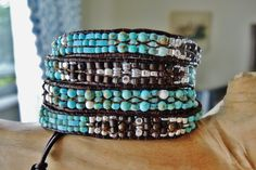 Designed and handmade by myself in North Carolina USA UNISEX>>>>UNIQUE handwoven design for this eye-catching genuine TURQUOISE, SILVER, and BRONZITE/browns in this 4 Wrap Rich Antique Brown( lead-free) Leather...with sterling Silver and silver plated faceted Beads,Miyuki Half Tilas, Seed Beads........Each piece is sewn through at least twice if not 6 times.if not 8 or more timed with sturdy Silamide Beading Cord for super durability. A slightly 4 closure options....measuring 30, 32.0 and…