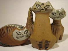Lisa Larson: Pottery Cats - Lisa Larson is a famous Swedish artist who has been creating collectible pottery works in Gustavberg, Sweden since the 50′s. The tabby cats are designed for the early Lila Zoo collection in 1955.